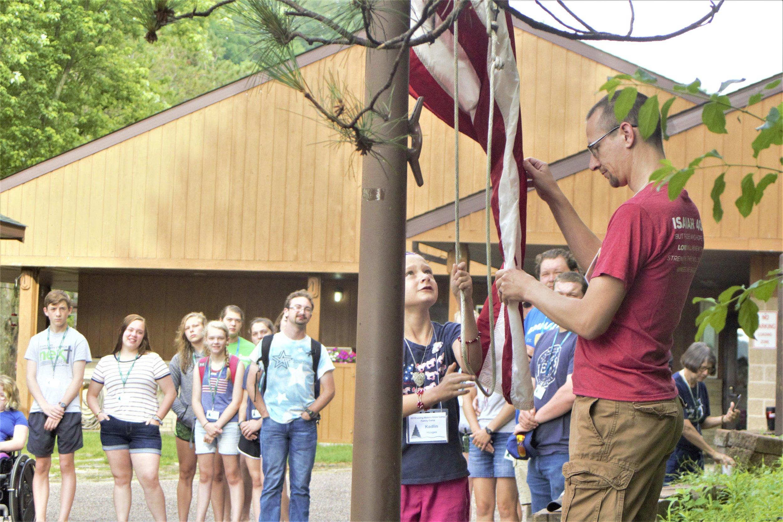 4th of July flag raising at Family Camp