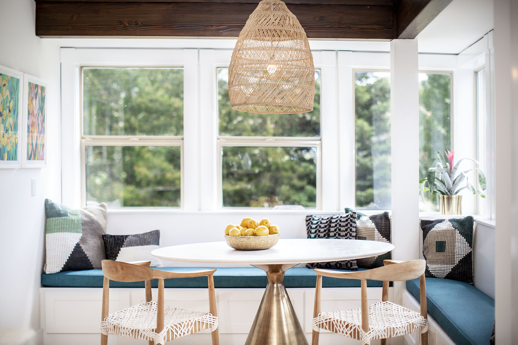 Bright breakfast room with custom banquette.