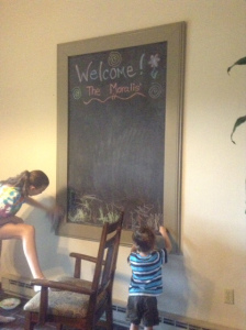 The kids enjoying a chalkboard project I worked on with my dad.
