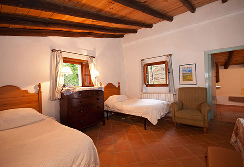 The twin-bedded room upstairs with en suite bathroom.