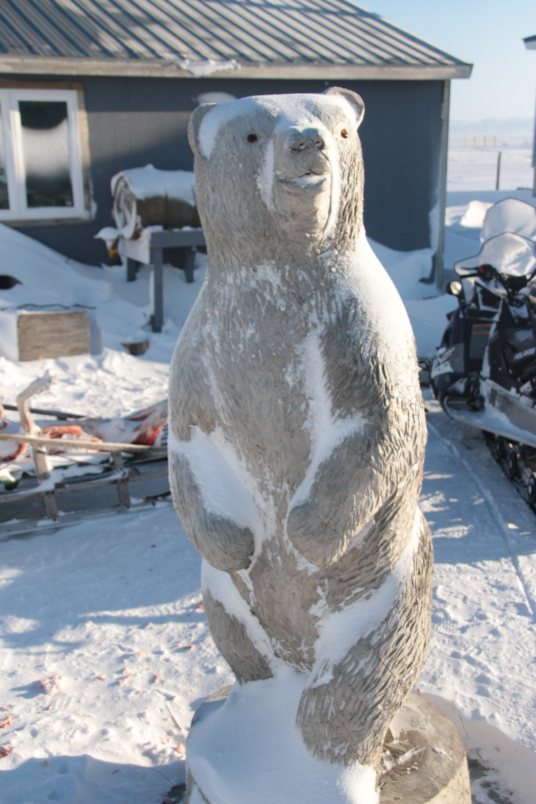 Polar Bear statue carved by Palmer Sagoonick.