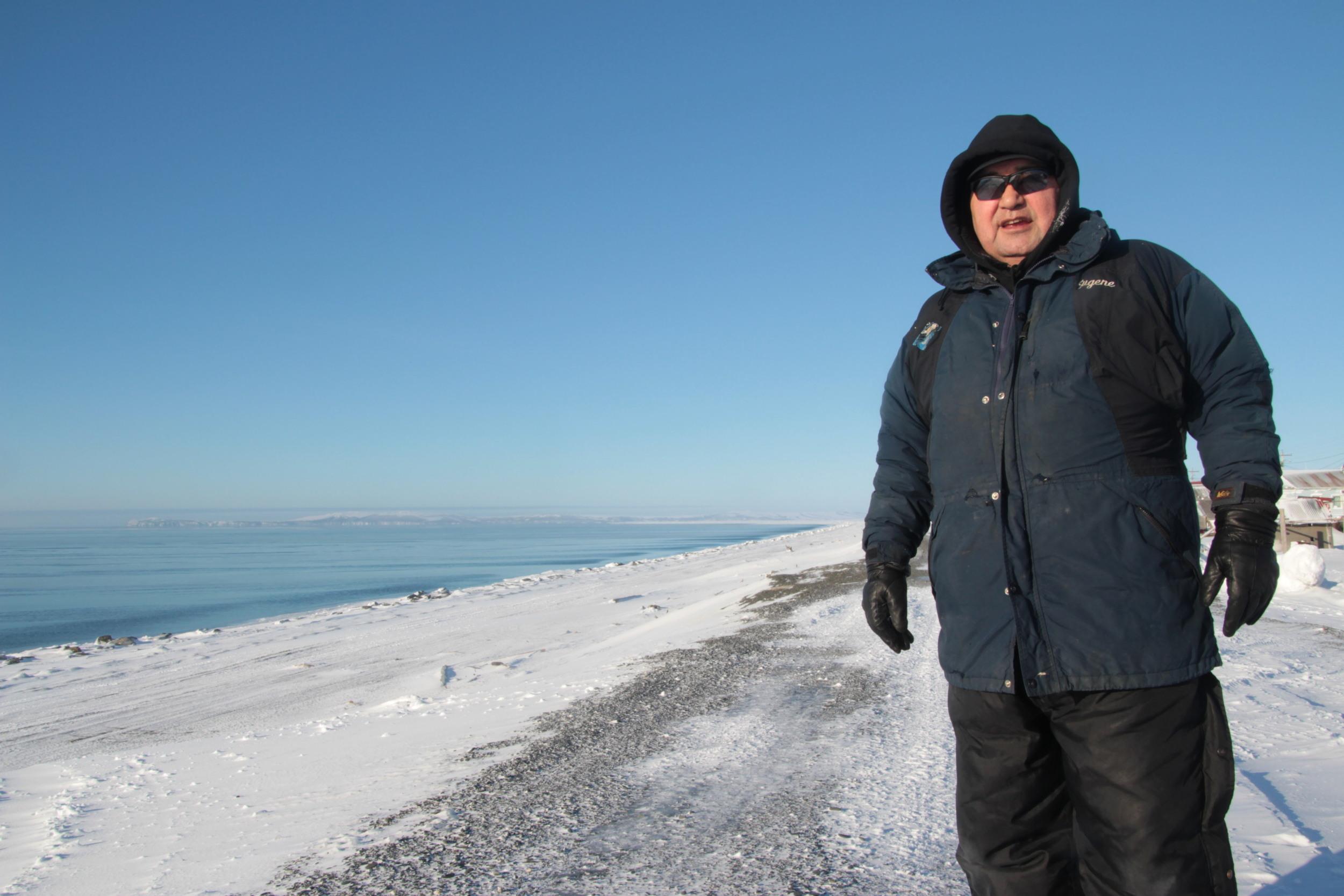 Eugene Asicksik standing on Shaktoolik's berm.
