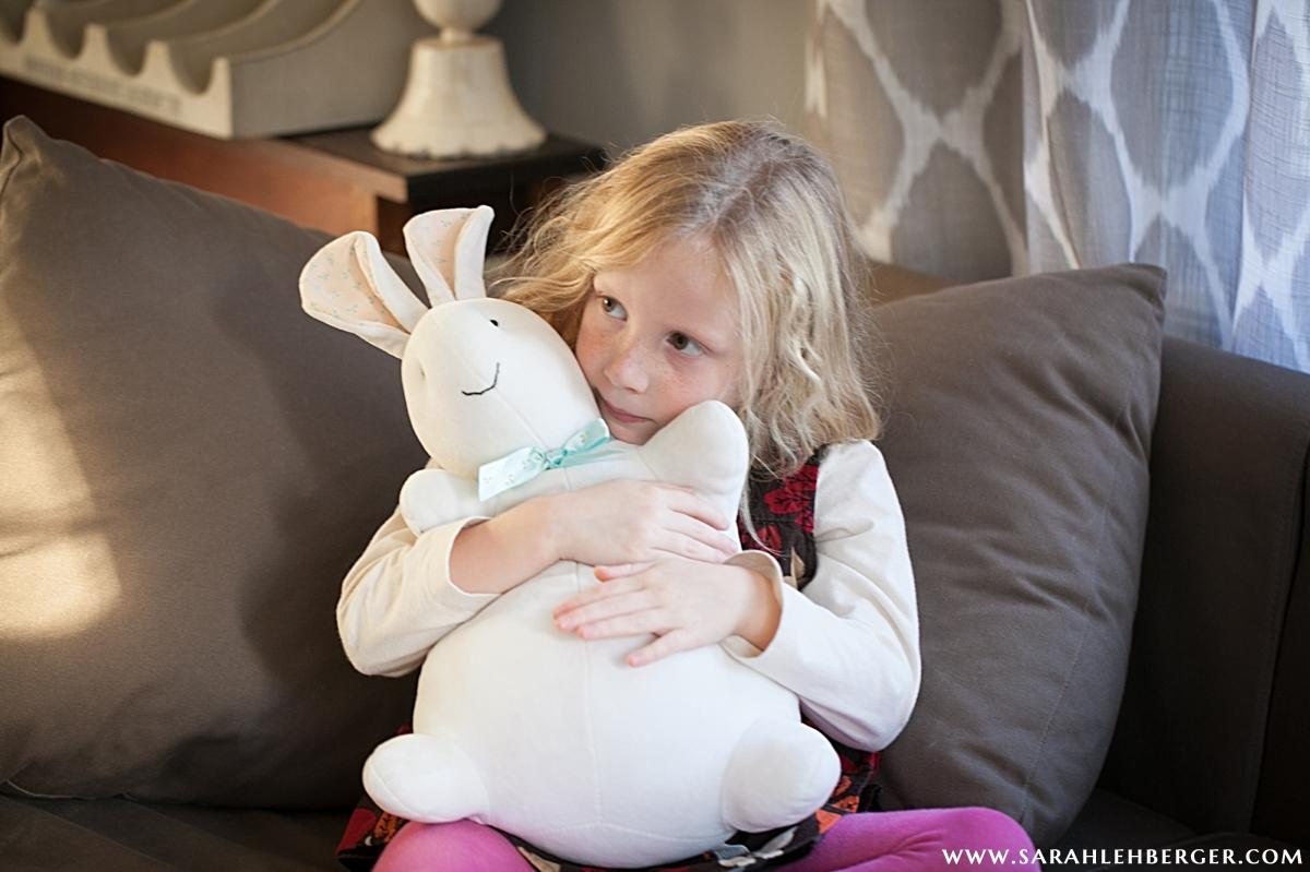 girl-snuggles-stuffed-animal-lovie.jpg