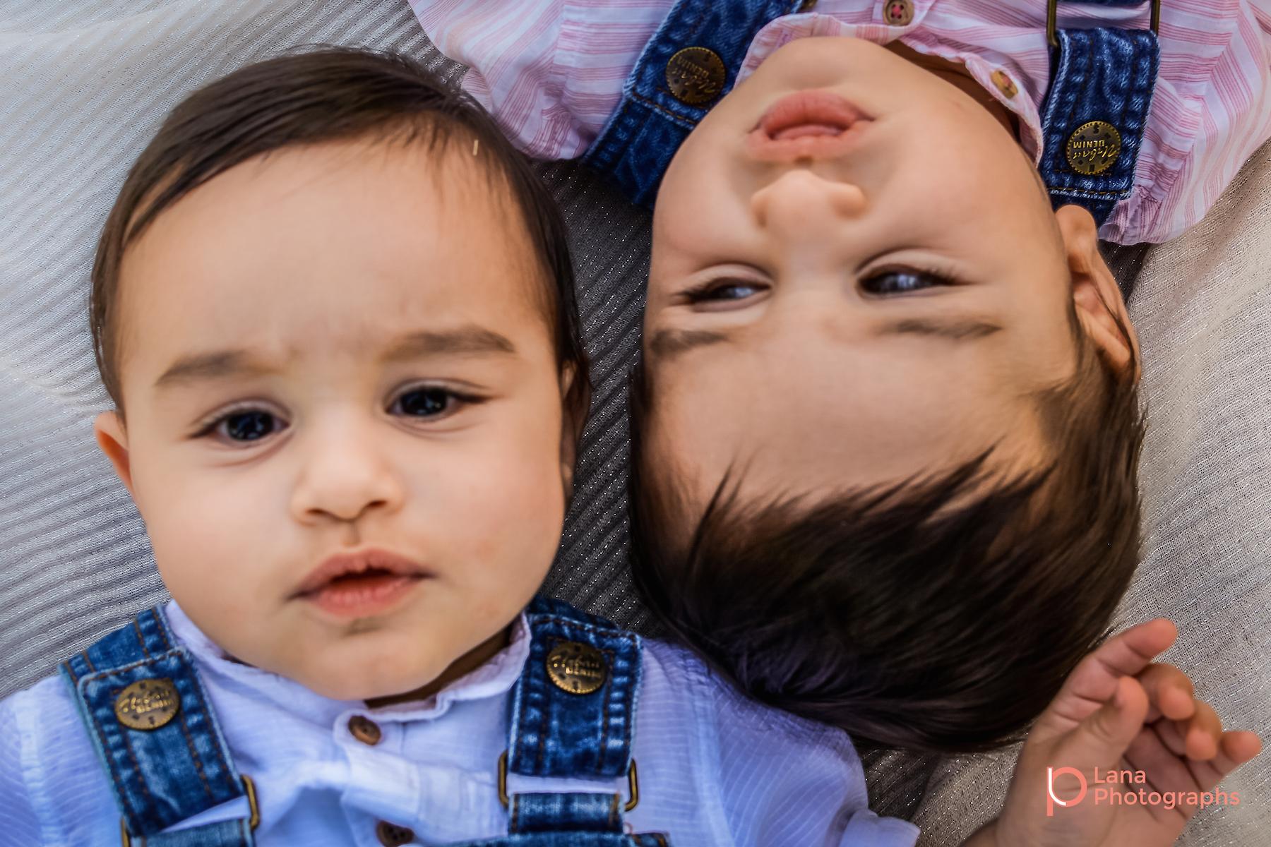 Dubai Family Photography twins posing on the grass