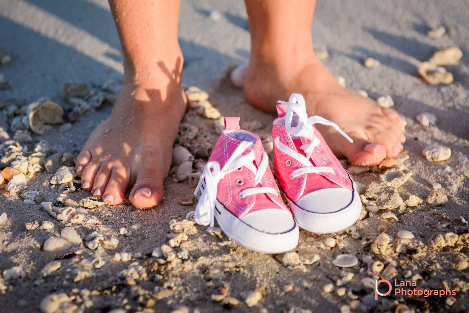 Dubai Maternity Photographer picture of mother's feet posing with her baby's shoes