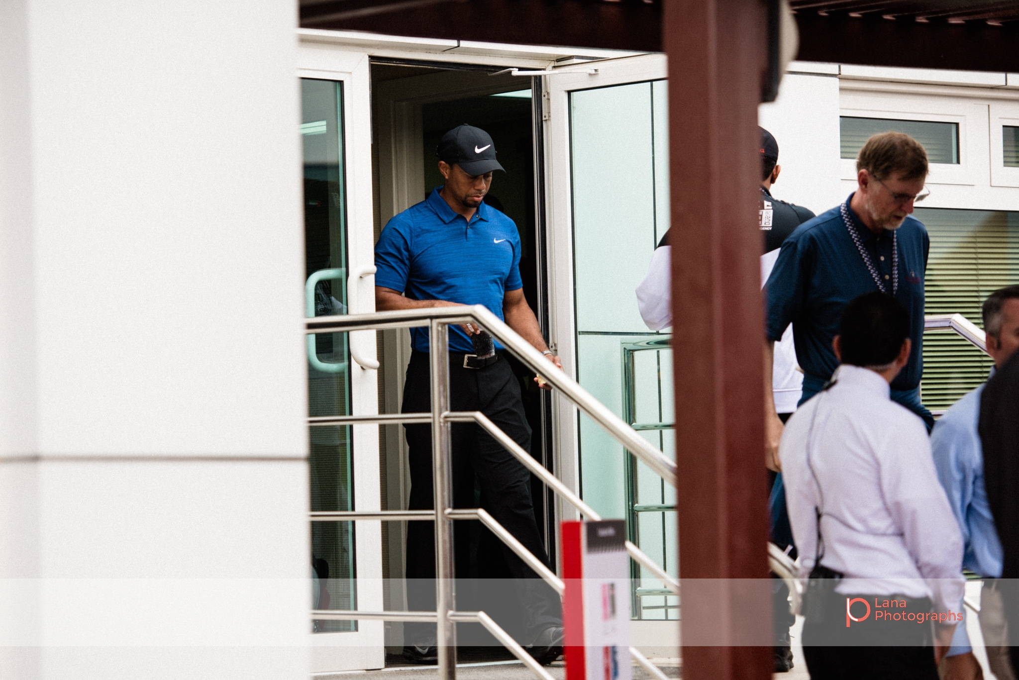 Tiger Woods leaves the organizers office during day 1 of the Omega Dubai Desert Classic in February 2017