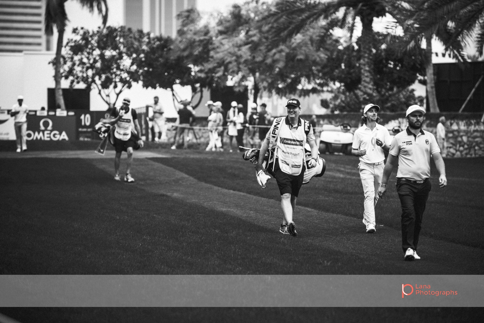 Tour players walking across the grounds at the Omega Dubai Desert Classic