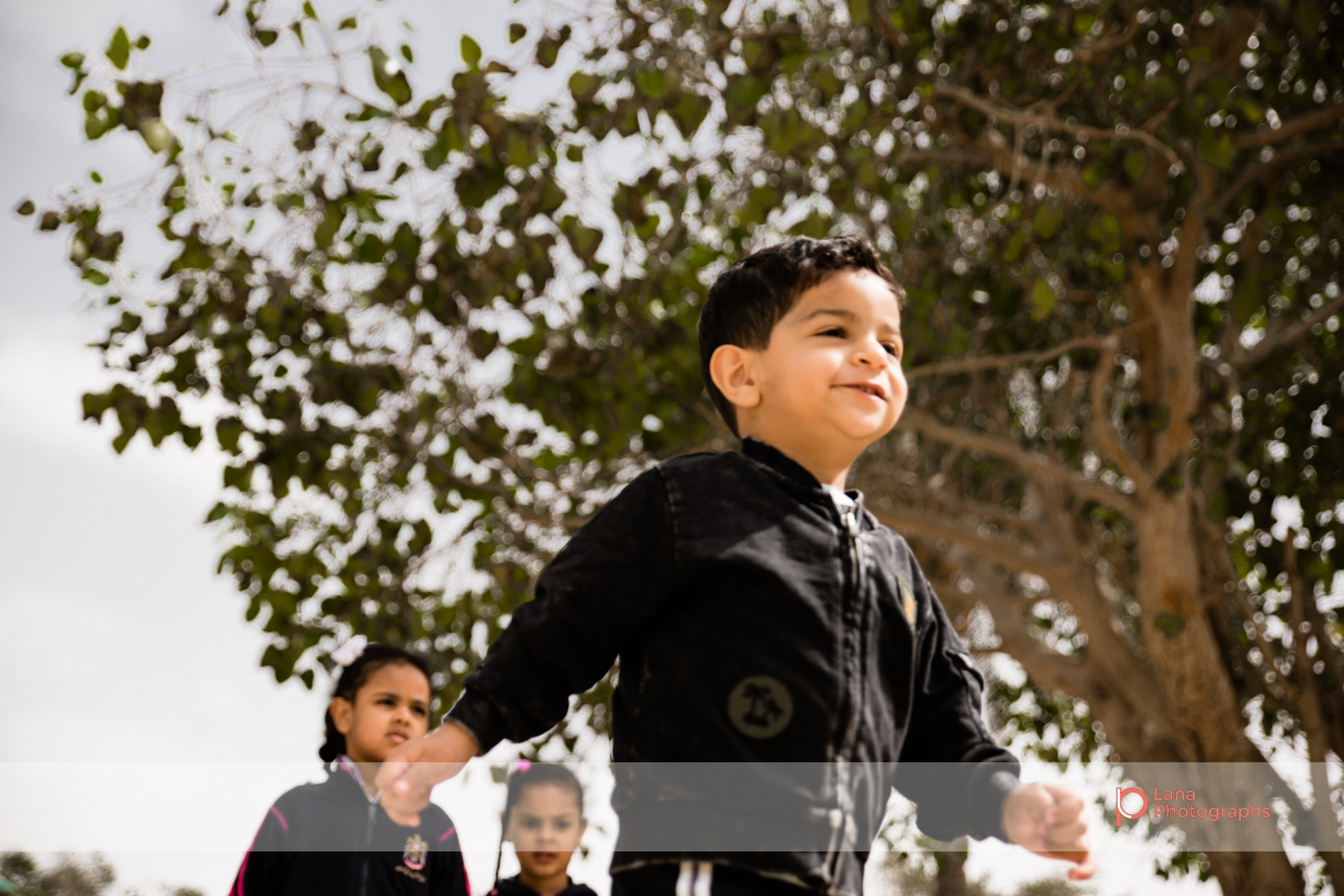 Dubai Family Photographer little boy running in Umm suqeim park Dubai