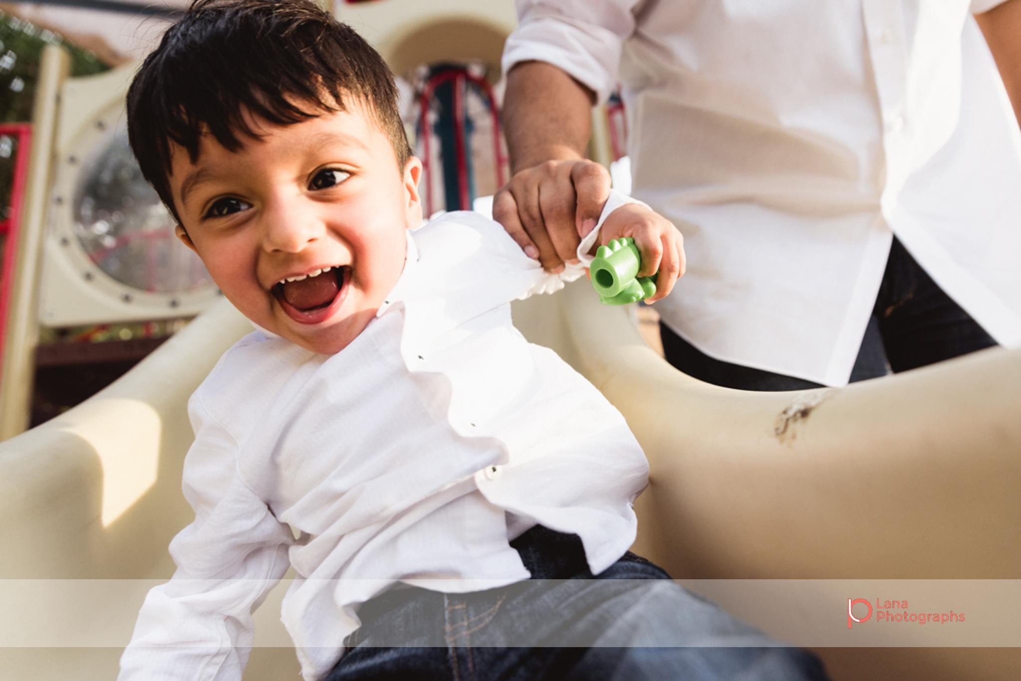 Lana Photographs Family Photographer Dubai Top Family Photographers baby boy sliding in the park