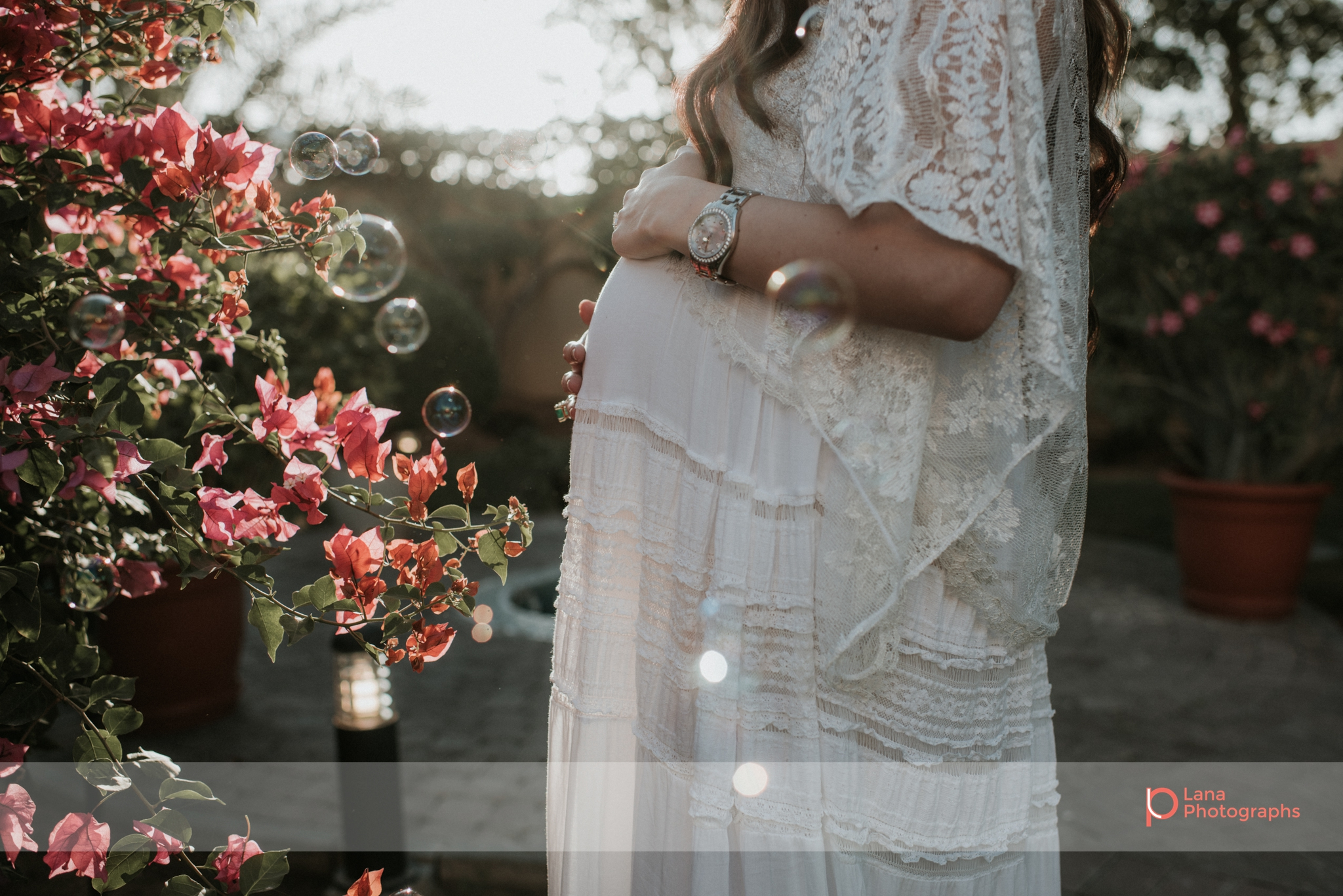 Lana Photographs Family Photographer Dubai Top Family Photographers portrait of a woman's pregnant belly in the golden hour
