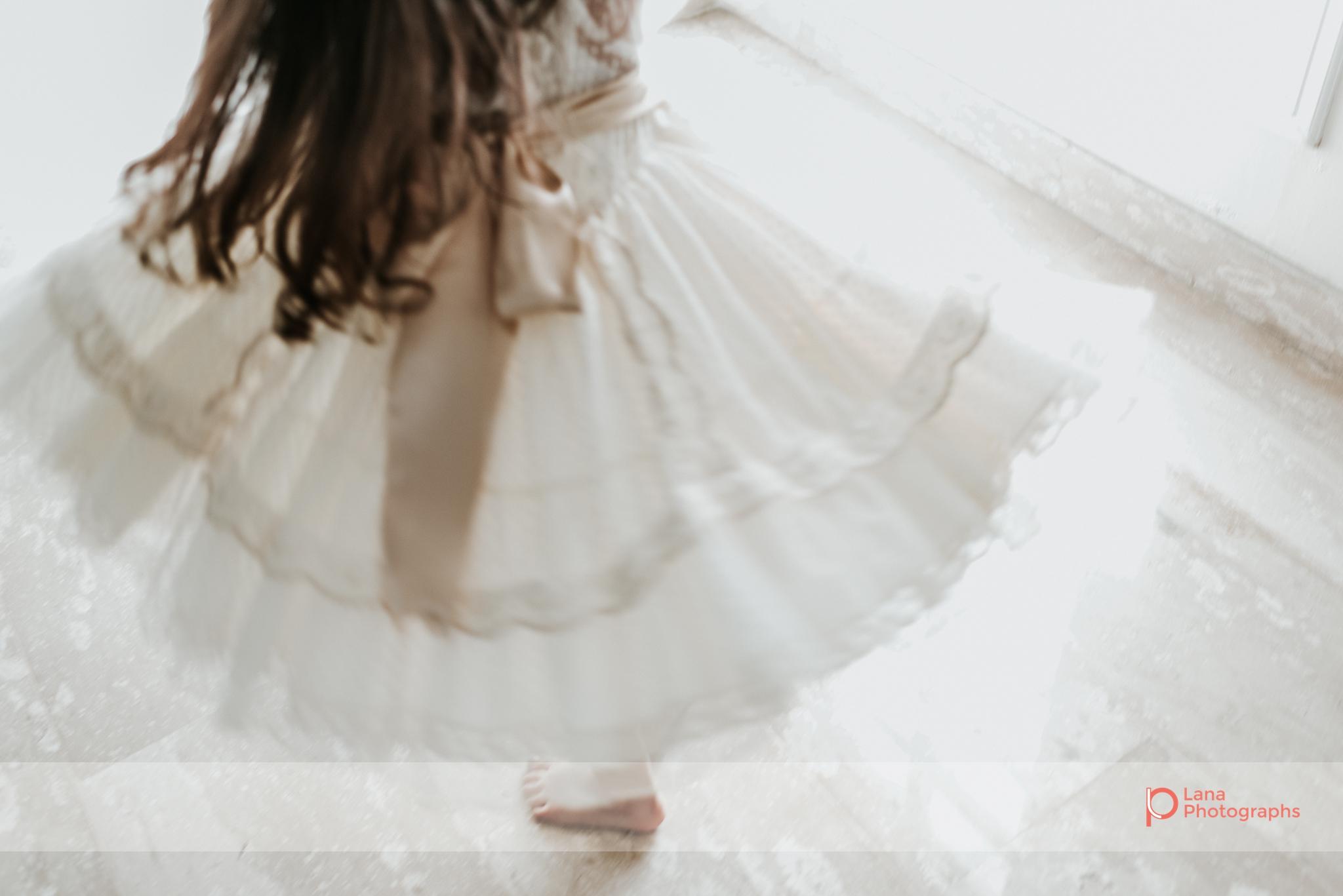 Lana Photographs Family Photographer Dubai Top Family Photographers portrait of little girl twirling