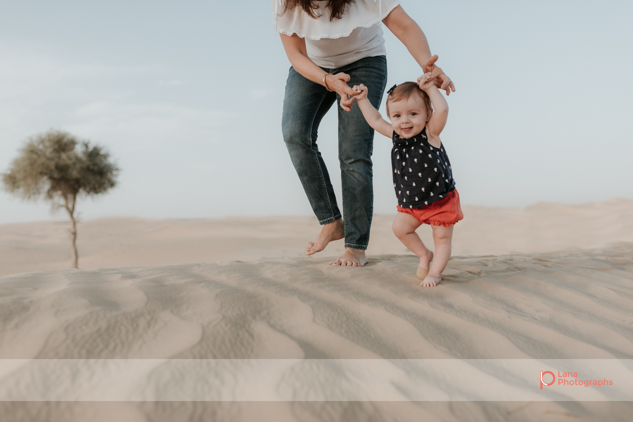 Lana Photographs Family Photographer Dubai Top Family Photographers mother walking her daughter in the desert