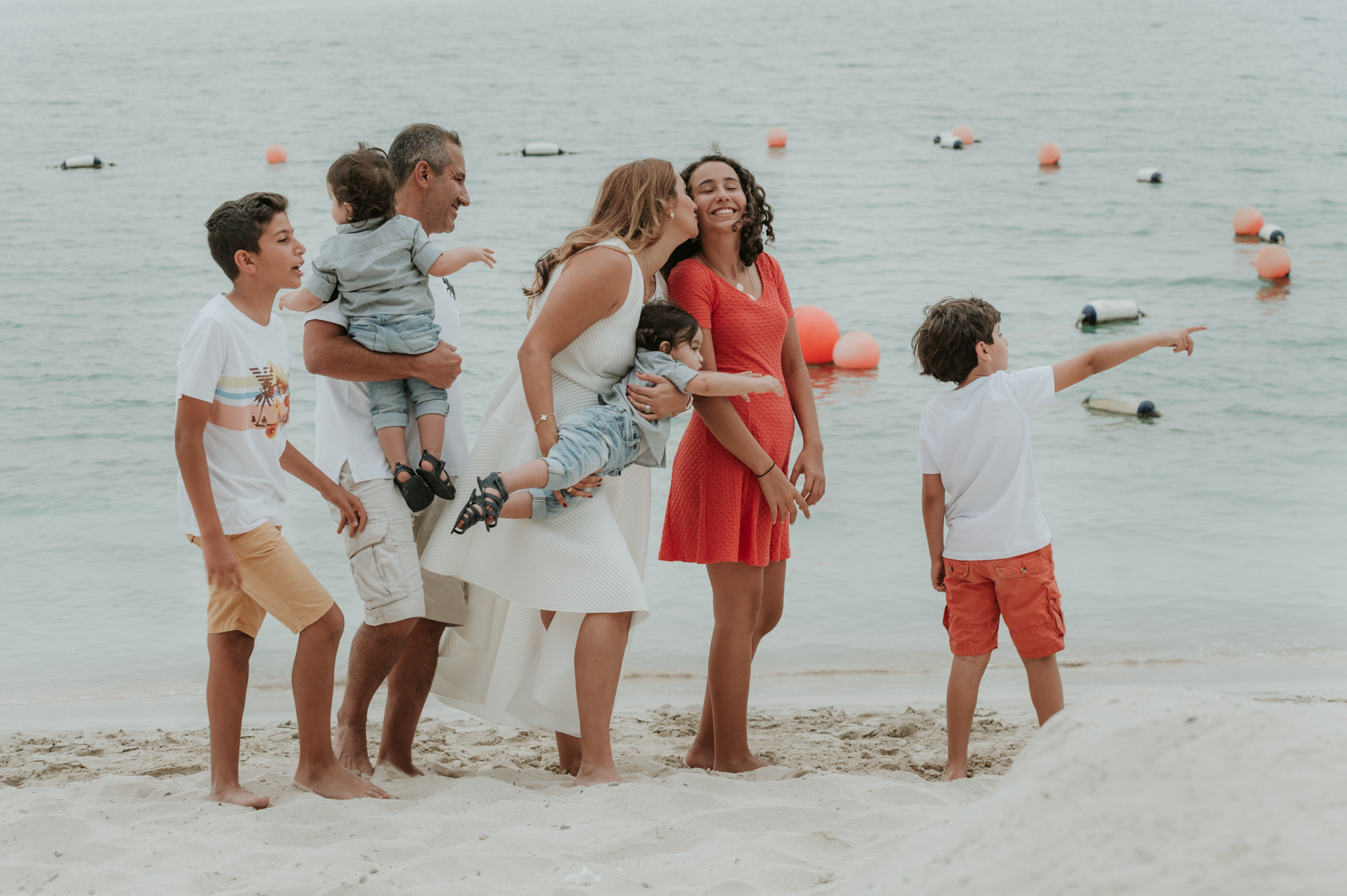 Lana Photographs Family Photographer Dubai Top Family Photographers family playing at the beach in Abu-Dhabi