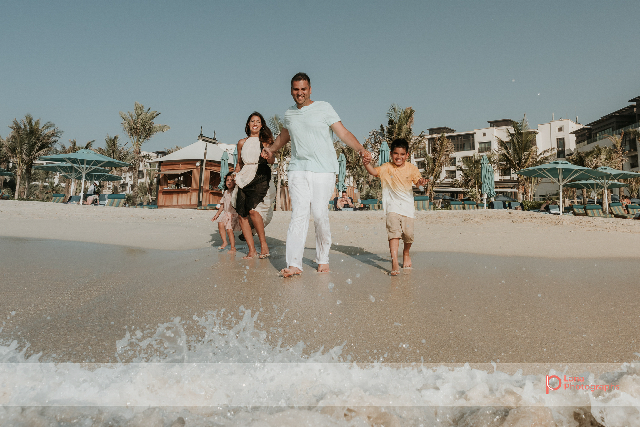 Lana Photographs Dubai Family Photography beach photoshoot family running into the water