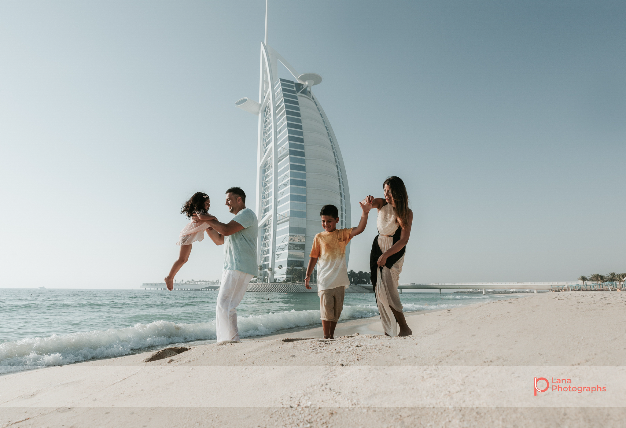Lana Photographs Dubai Family Photography beach photoshoot family shot with burj al arab in the background