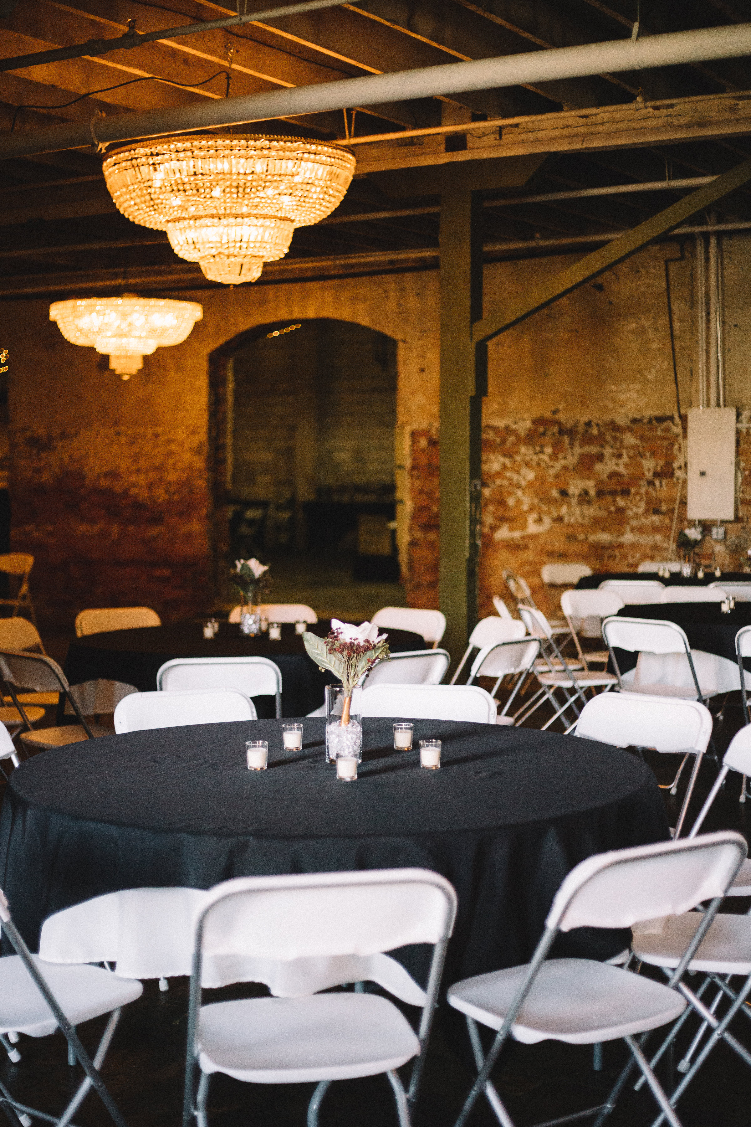 A few of the reception tables ready for guests to take their seats.
