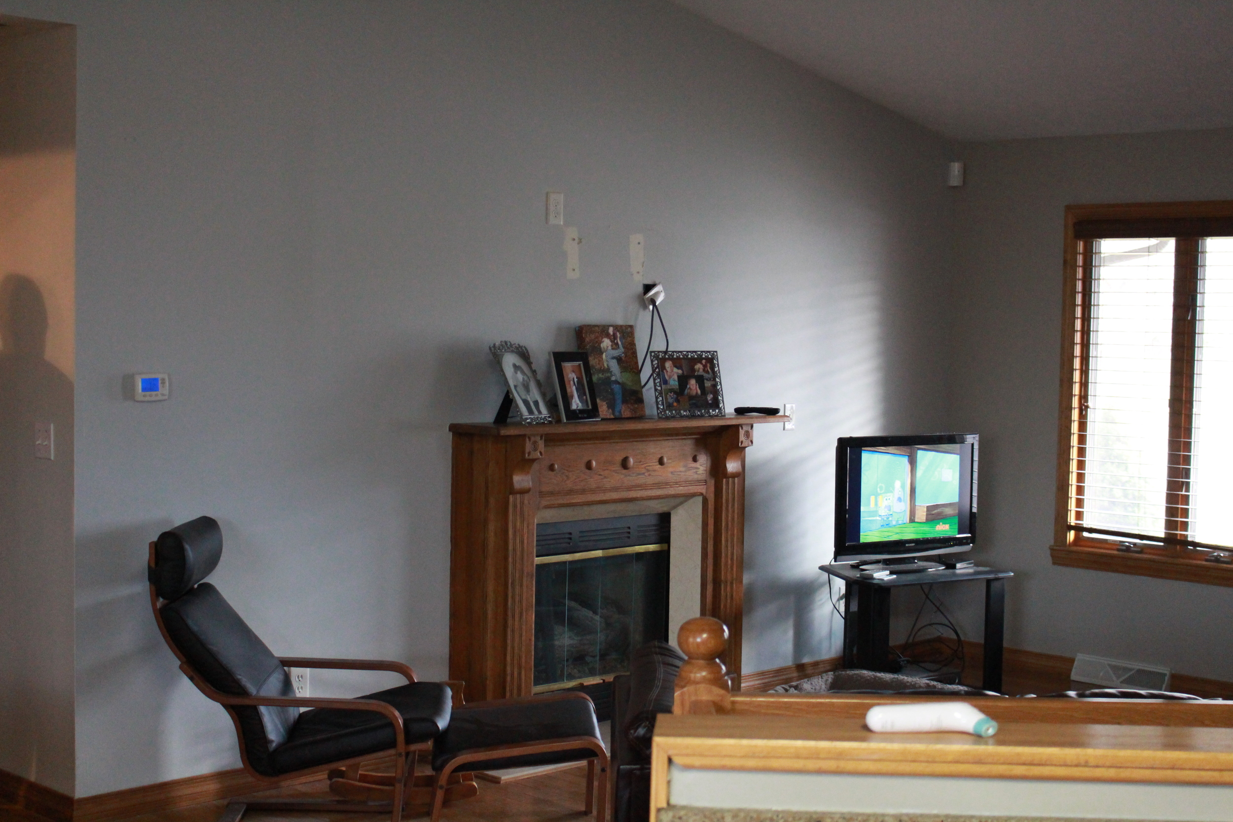 Before: The existing wood mantle was dated and boring. While it matched the trim, it did little to improve the overall appearance of the room.