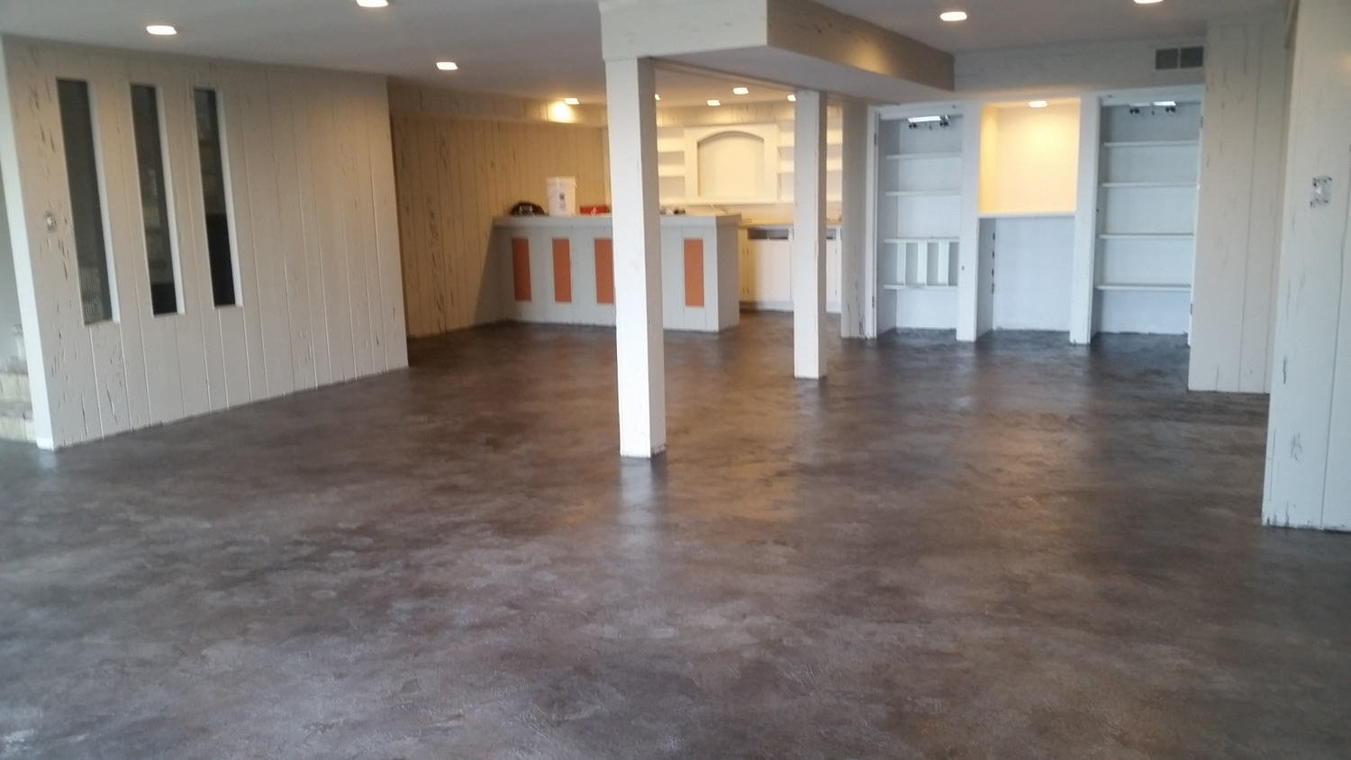 Micro-Topping on a finished basement floor. Renovations like this are popular when homeowners decide to expand their living space into the basement to accommodate growing families and entertaining needs. Job By Concrete Ink - click image to view their profile.