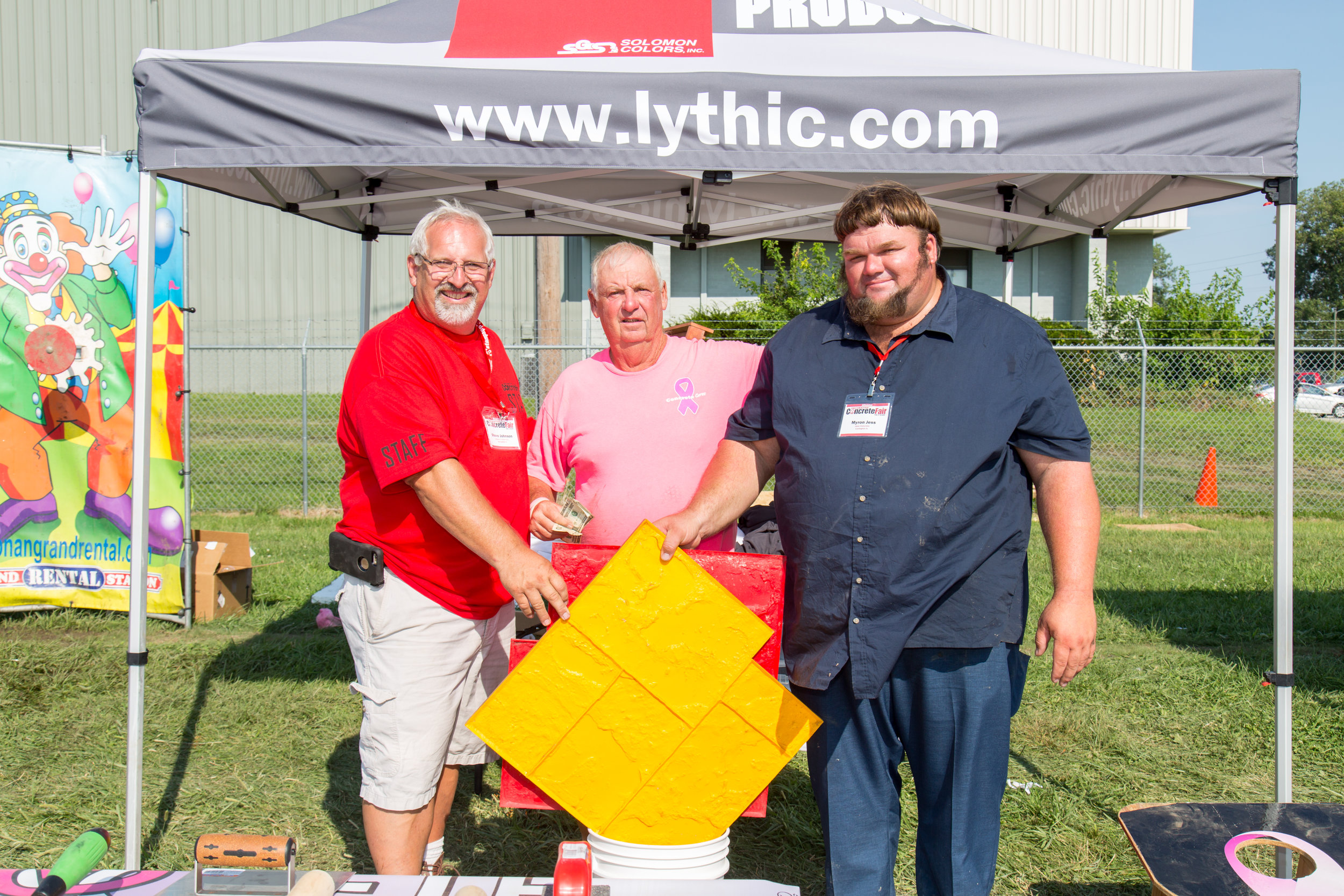 Mike Murray (Concrete Cares) and Steve Johnson (Solomon Colors) present a stamp set to the raffle winner at the 2017 Decorative Concrete Fair.