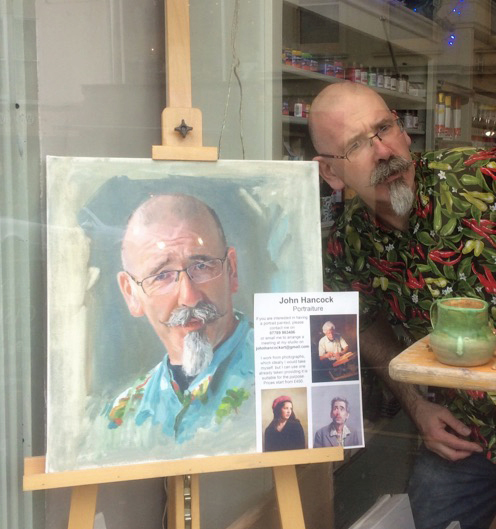 Adam with his portrait at the Art Shop