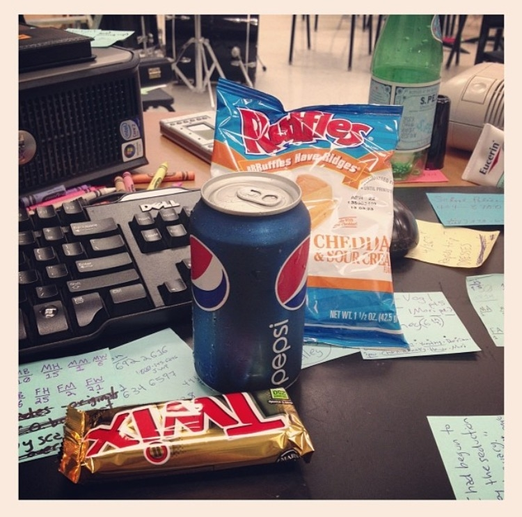Image description: my desk, lots of post-it notes, and my lunch for the day -- a Twix bar, can of Pepsi, and a bag of Sour Cream & Cheddar Ruffles chips.