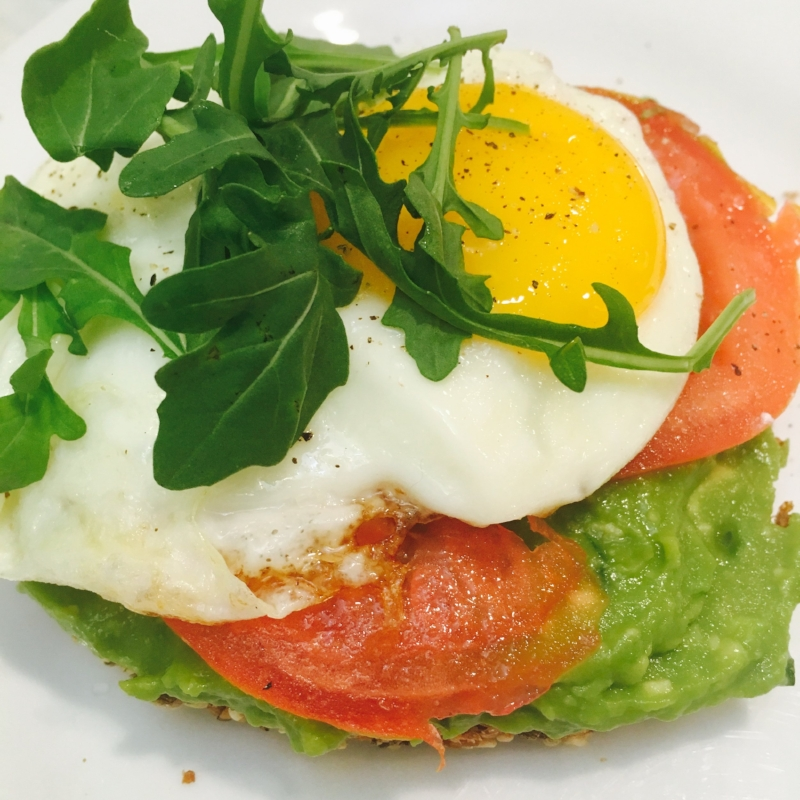 """Image description: avocado toast, i.e. mashed avocado (I added fresh rosemary!) on super hippie sprouted grain bread, topped with tomato slices, a fried egg, and a little bit of arugula. Sugar free is actually pretty """"sweet""""."""
