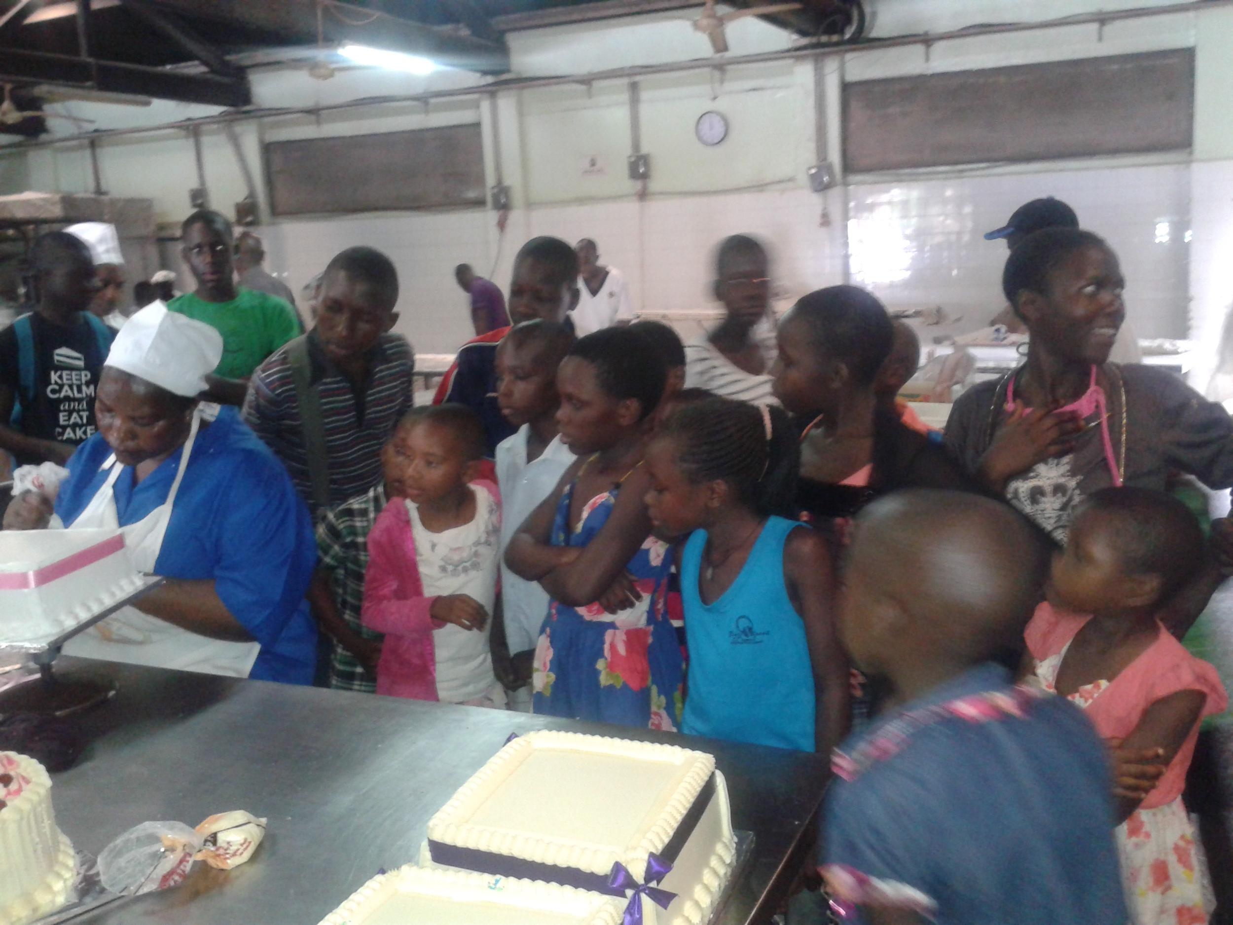 Uganda children visiting bakery.jpg
