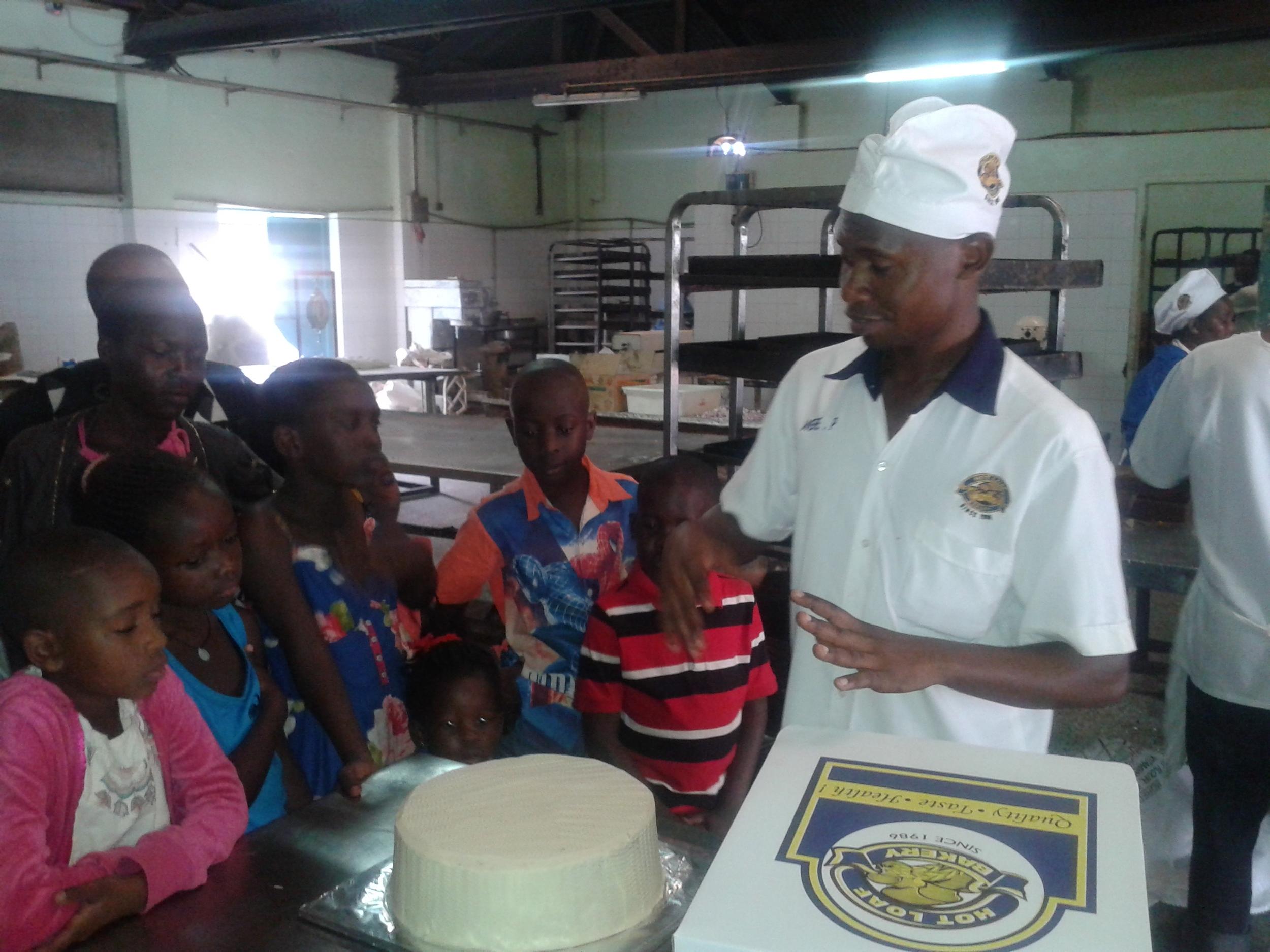 Uganda winners -Baker explains cake making at Hot Loaf Bakery .jpg