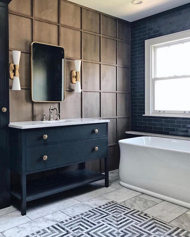 Love this stunning bathroom by @jeanstofferdesign . It's the perfect mix of classic and contemporary design. . . #madeleineinteriors #inspiration #jeanstofferdesign #bathroom #bathroomdesign #classicdesign #contemporarydesign #interiordesign #contemporaryclassic #interiors #classiccontemporary #luxeliving #bathroomfloor #woodpaneling #color #marble #marblebathroom #contemporarylighting #tile #subwaytile #elledecor #masterbathroom #designinspiration