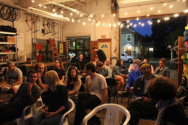 Audience assembles at Bradley Street Bike Co-op (Thomas Breen photo)