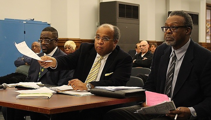 Lawyer Erskine McIntosh (center), with ESMS's Arnold Johnson (left) and Curtis McBride (right) at hearing.