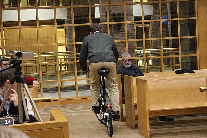 Legislative rider: Alder Adam Marchand samples prototype at hearing.