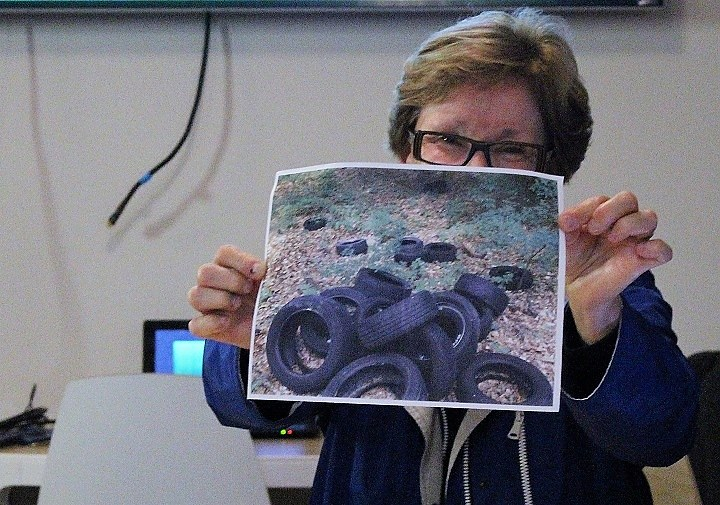 Andrea Konetchy with picture of recent tire dump in East Rock Park.