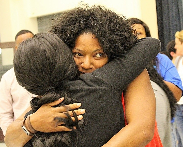 Kim Edwards, Sarah Ofosu embrace after their primary.