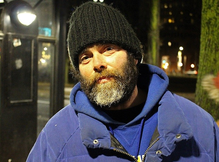 A man who reconnected with his Columbus House case worker on the Green during Tuesday night's Point-In-Time (PIT) homeless count.