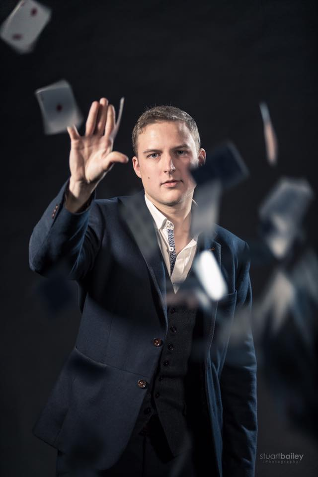 Iain Bailey London Wedding Magician plays 52 card pick up