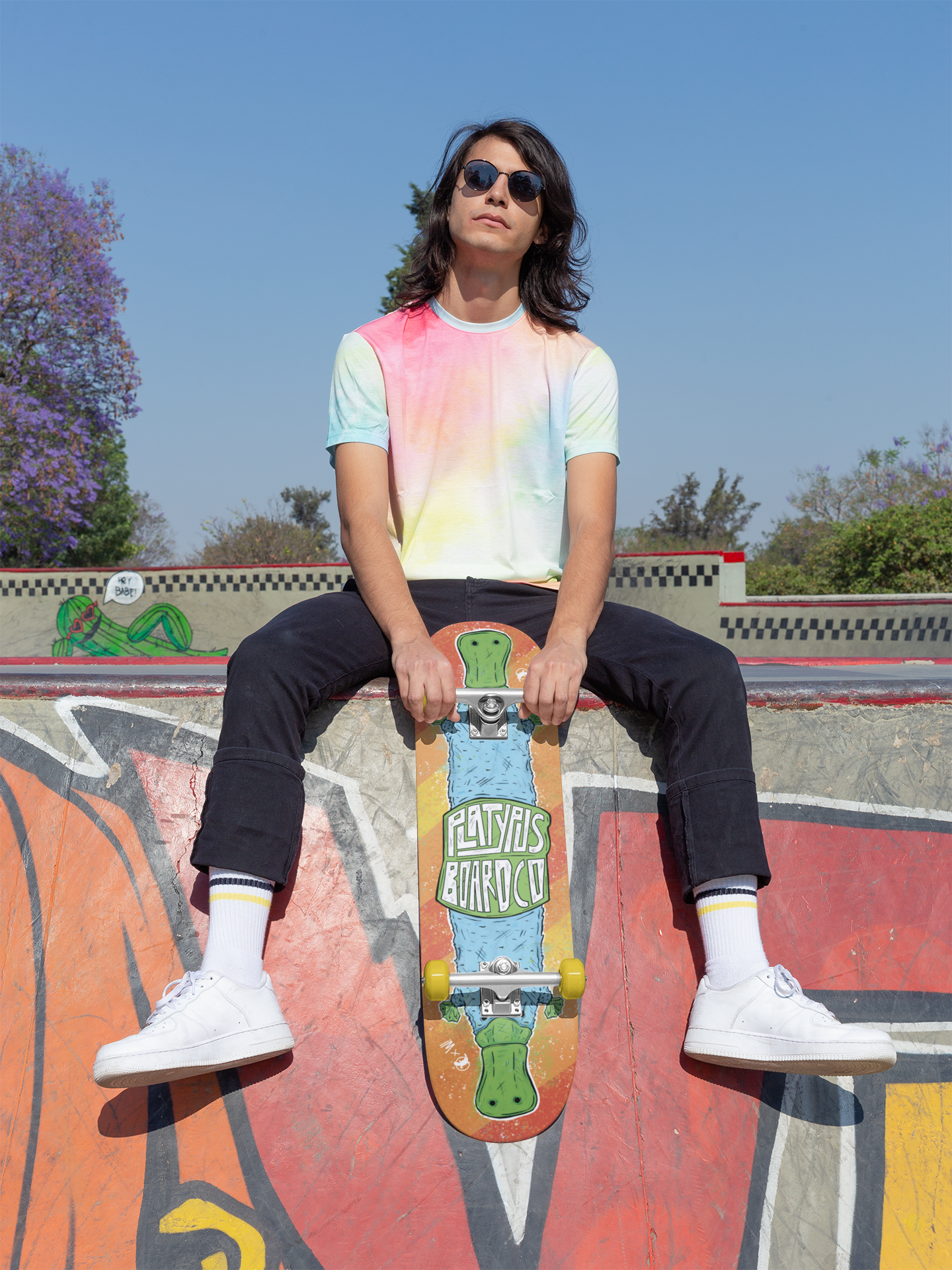 mockup-of-a-cool-man-holding-a-skateboard-27192.png