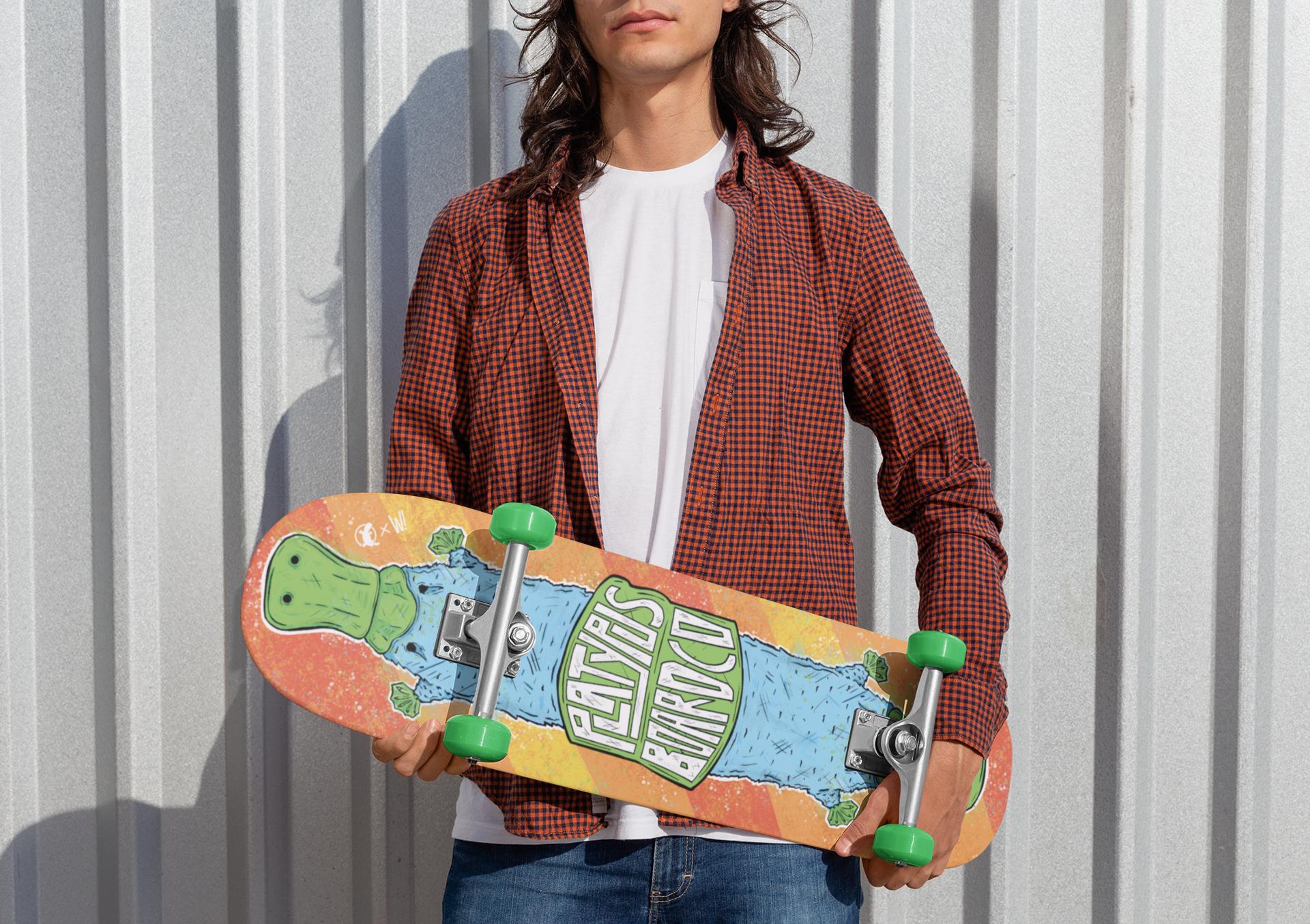 mockup-of-a-rebel-man-holding-a-skateboard-27201.png