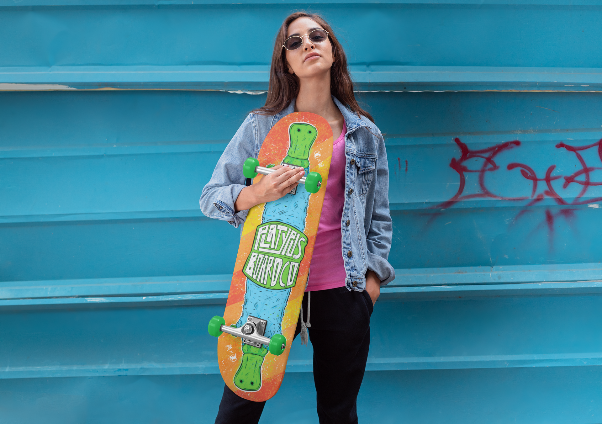 mockup-of-a-woman-holding-with-sunglasses-holding-a-skateboard-27122.png