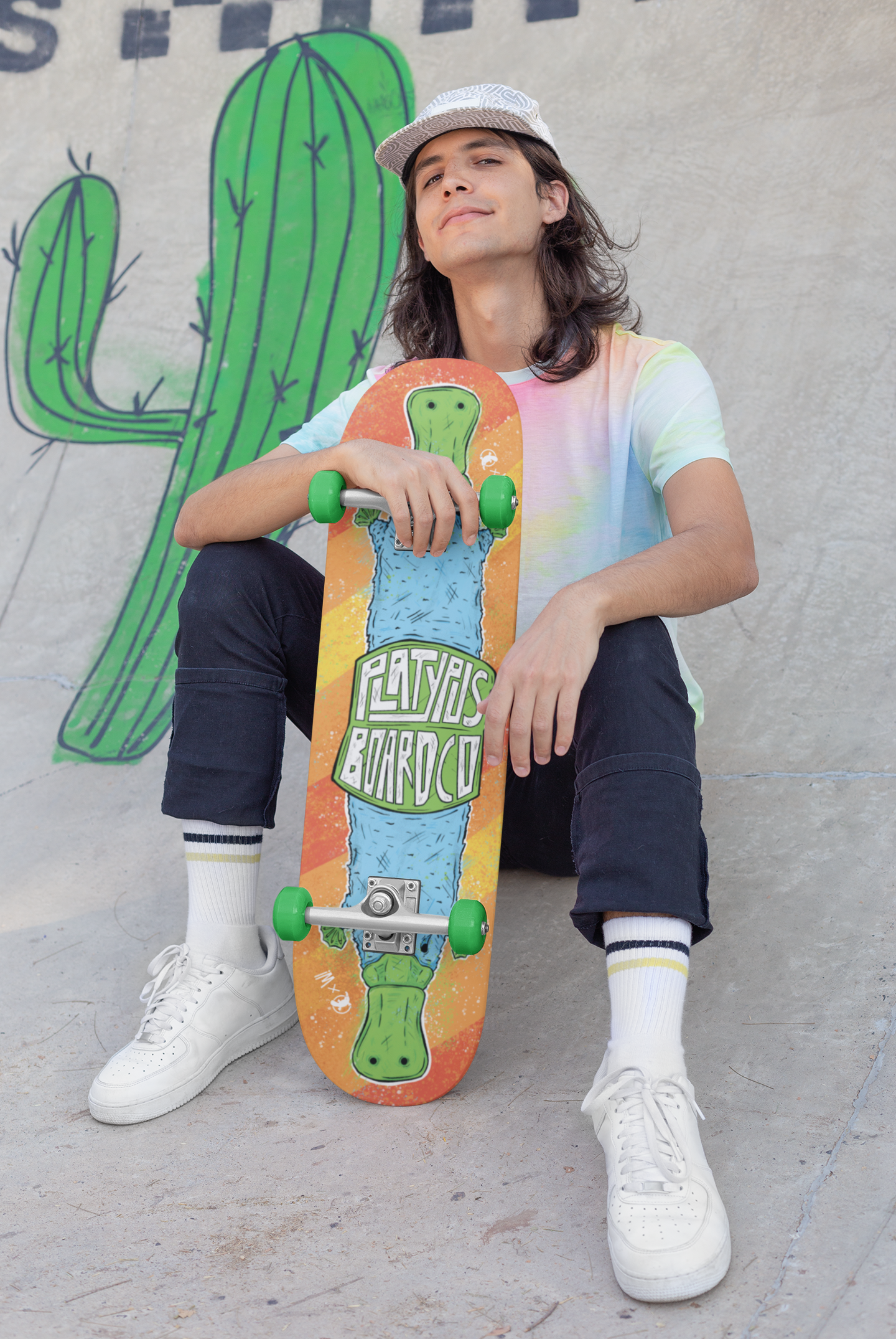 skateboard-mockup-featuring-a-long-haired-man-sitting-on-a-ramp-27191.png