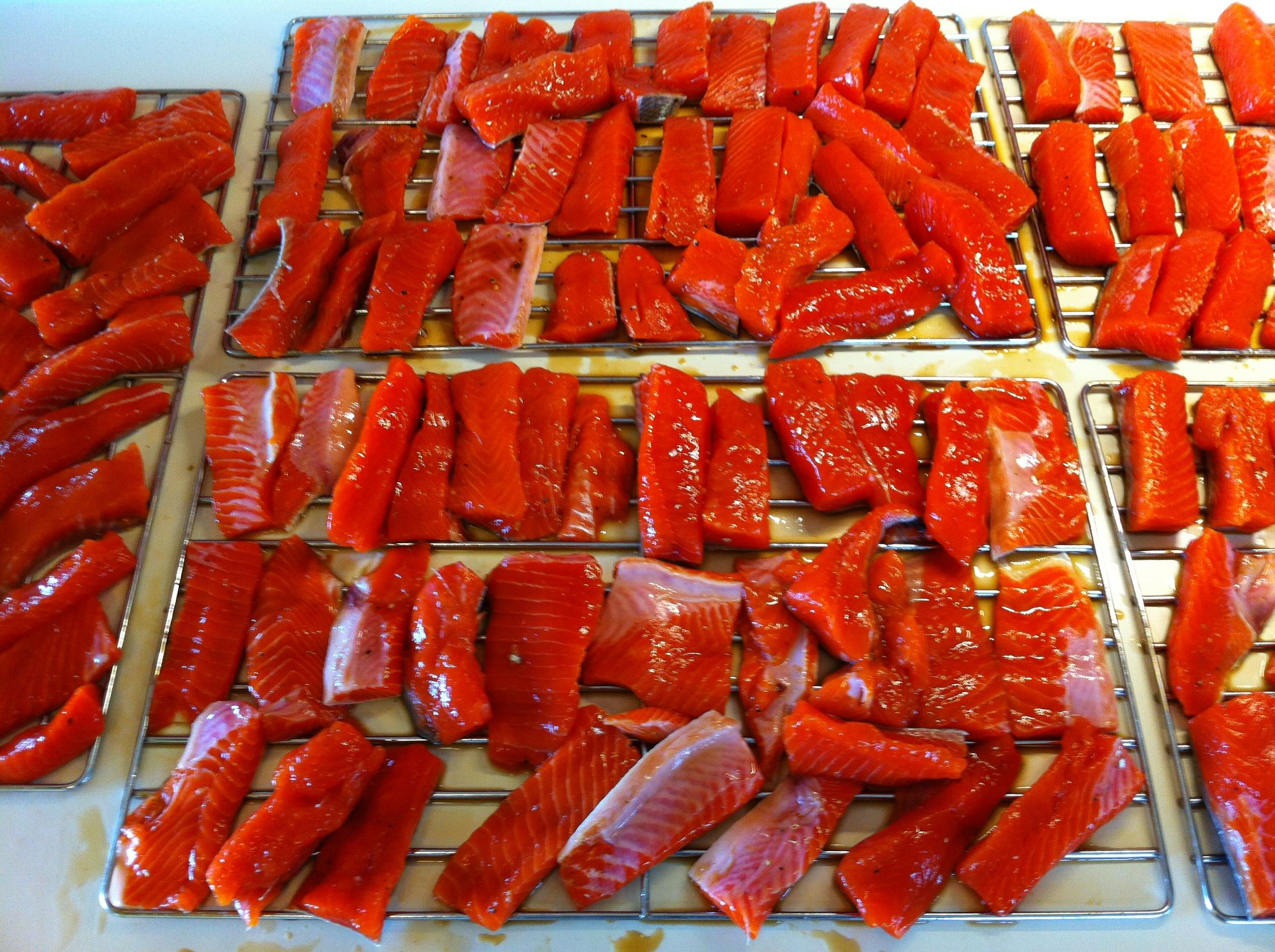 Air drying the glazed salmon strips