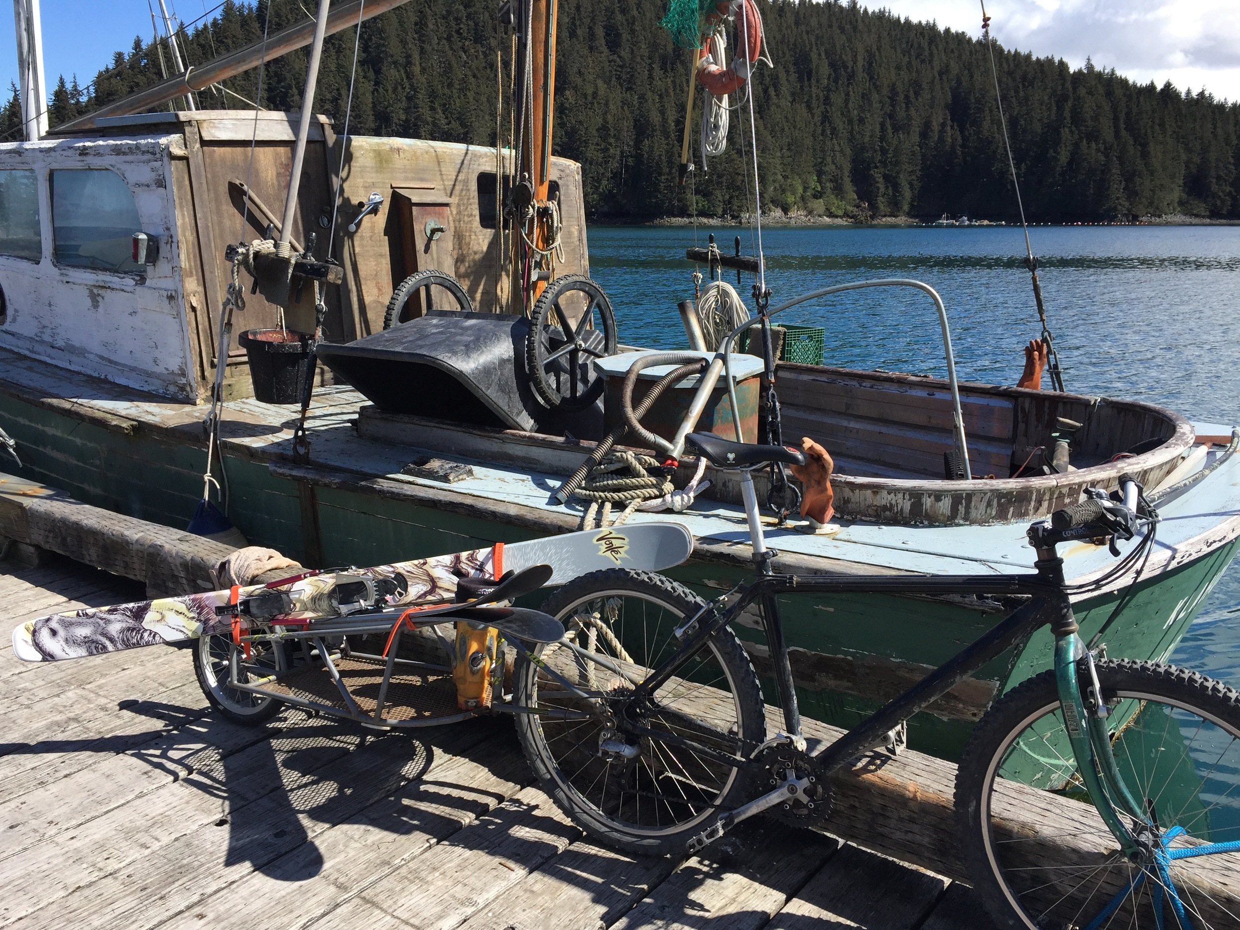 Getting ready to go skiing at the Jakolof Bay Dock next to a neat old wooden boat.