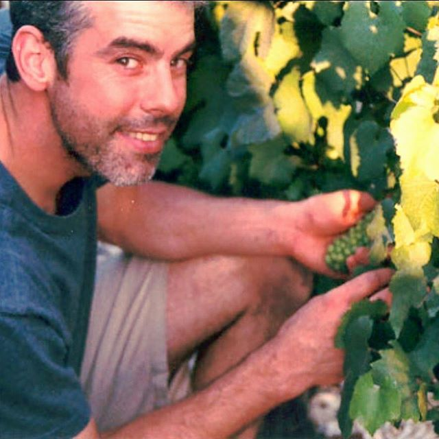 That's me in the Blanchot #grandcru #vineyard on the southwestern hillside in Chablis, France holding #chardonnay #grapes #tbt #throwbackthursday #wine #gourmet #chef