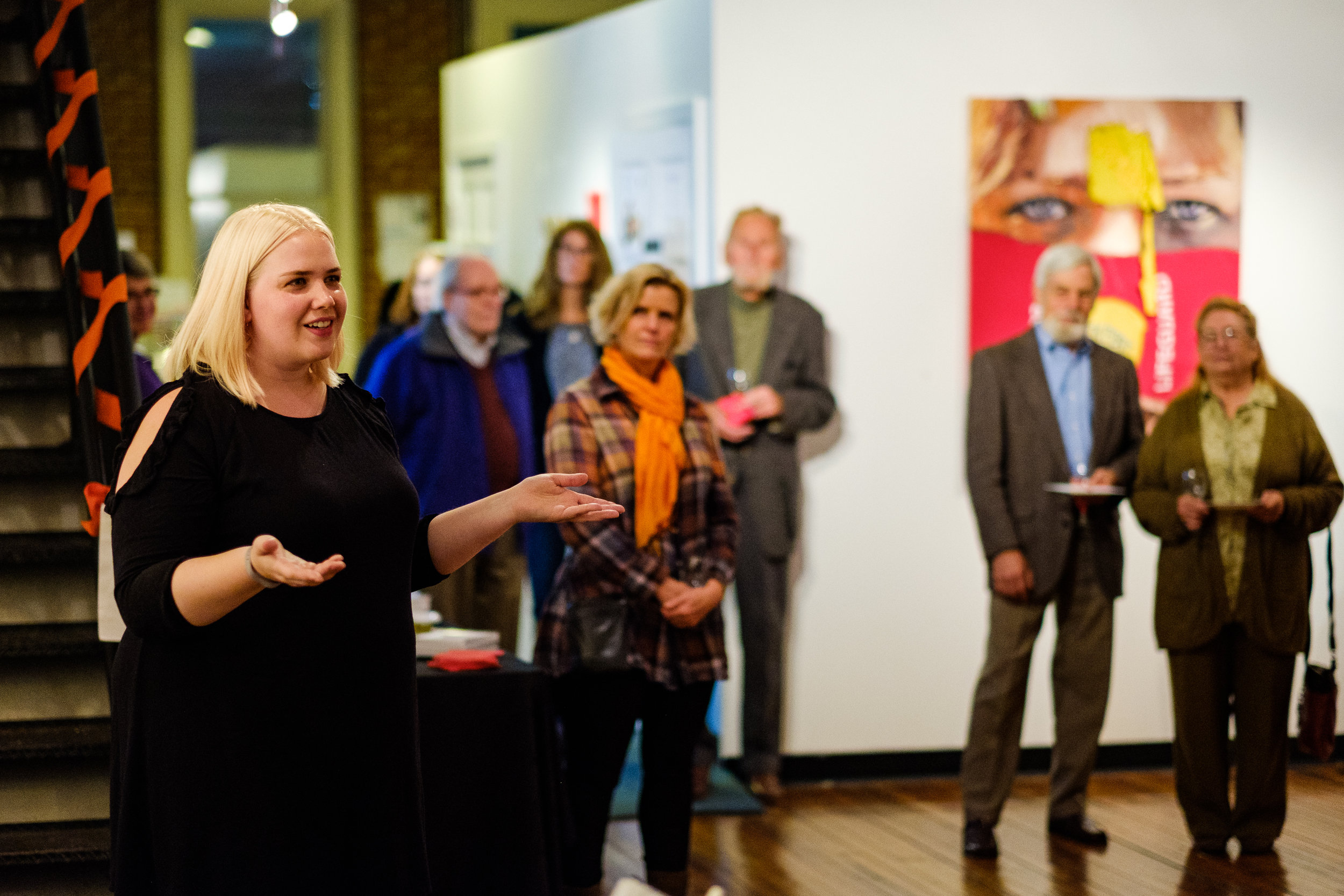 Miss Milliken giving an artist talk at the opening for  Portrait, Interrupted: Recycling and Renewing the Personal
