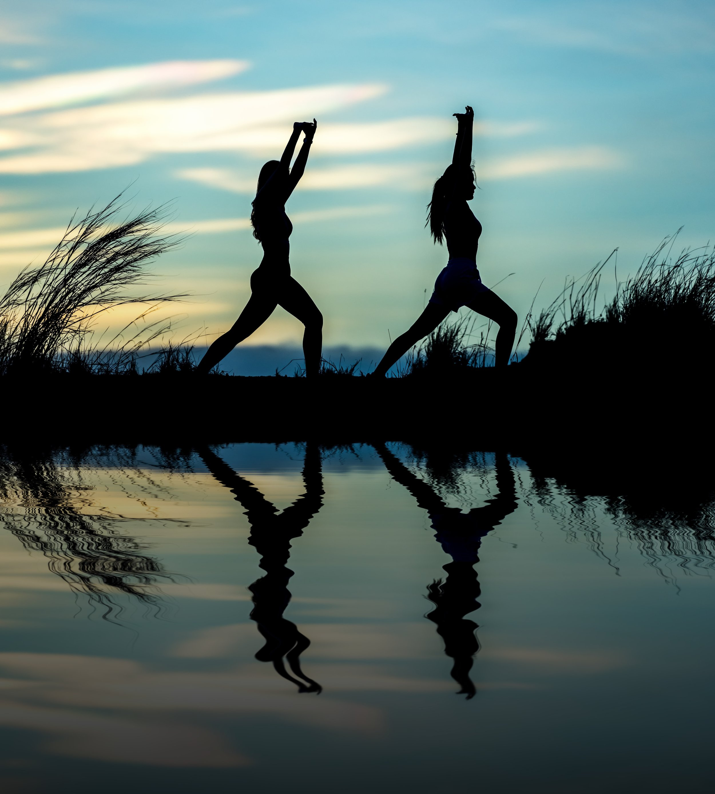 Mindful Movement Image, Two People Doing Yoga Stretches By a Lake