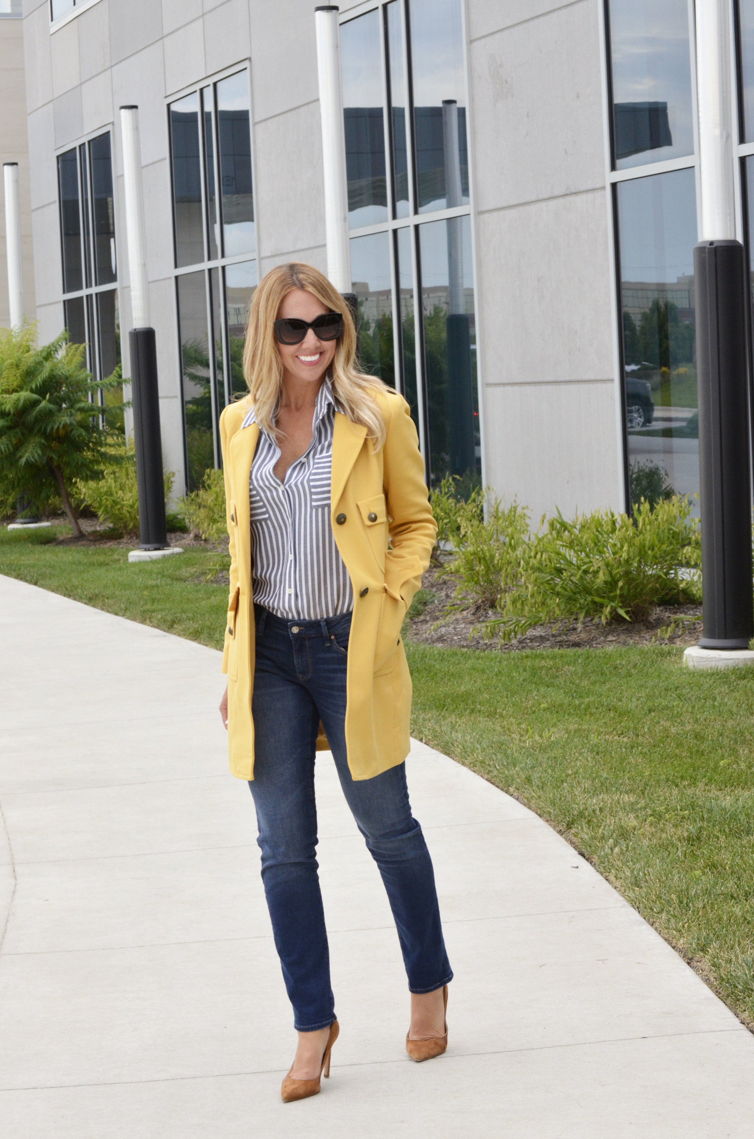 The Stroll saffron-colored coat and striped blouse