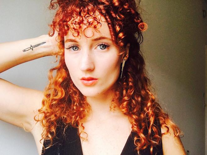 Goddess power earrings by  Marcia Vidal . Non toxic lipstick by  Ilia Beauty .