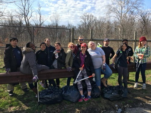 Photo from the Haddington Woods Vine Pulling event in April in partnership with the Fairmount Park Conservancy