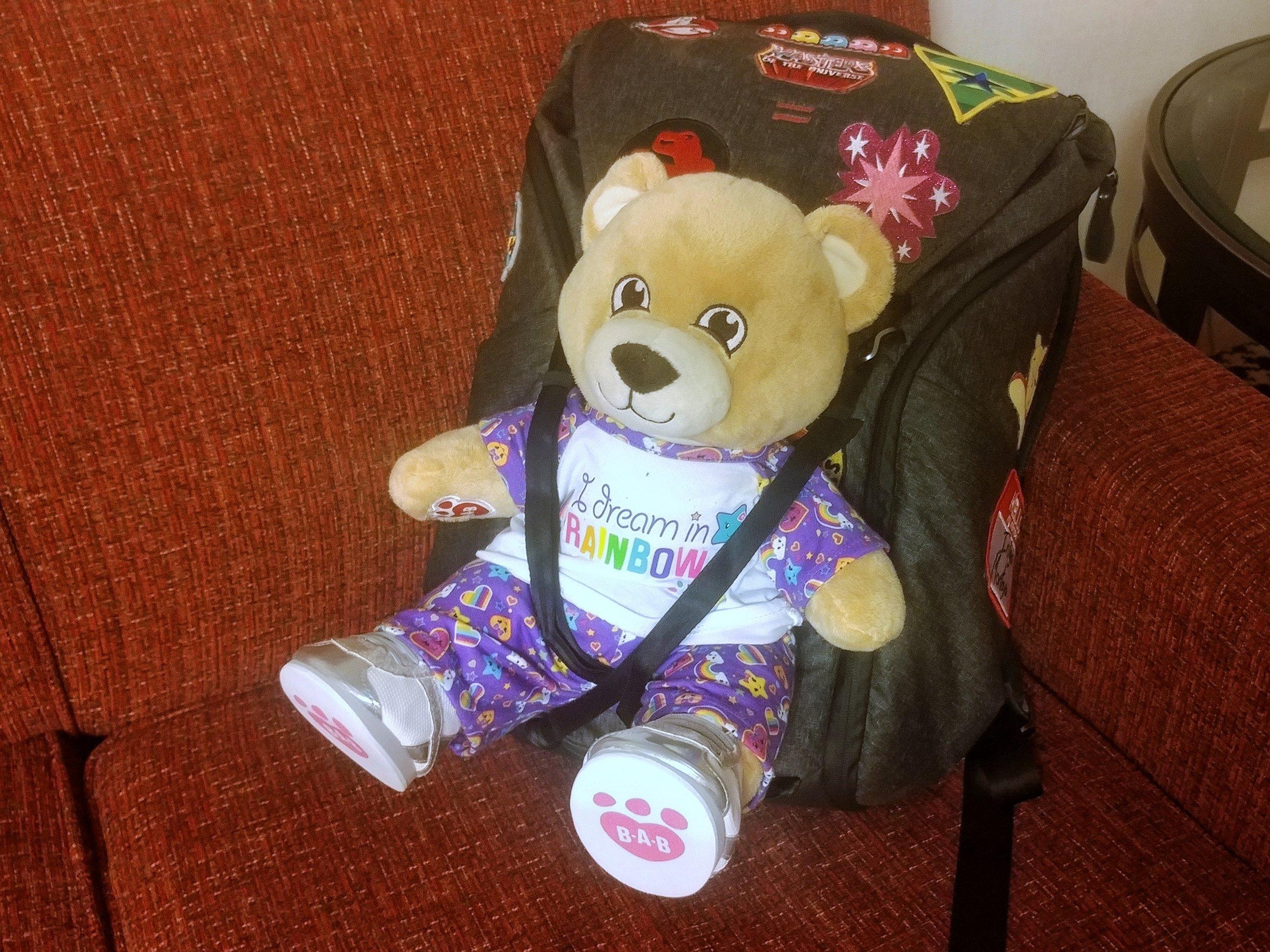 Lisa riding in  Peak Design's bear carrying straps