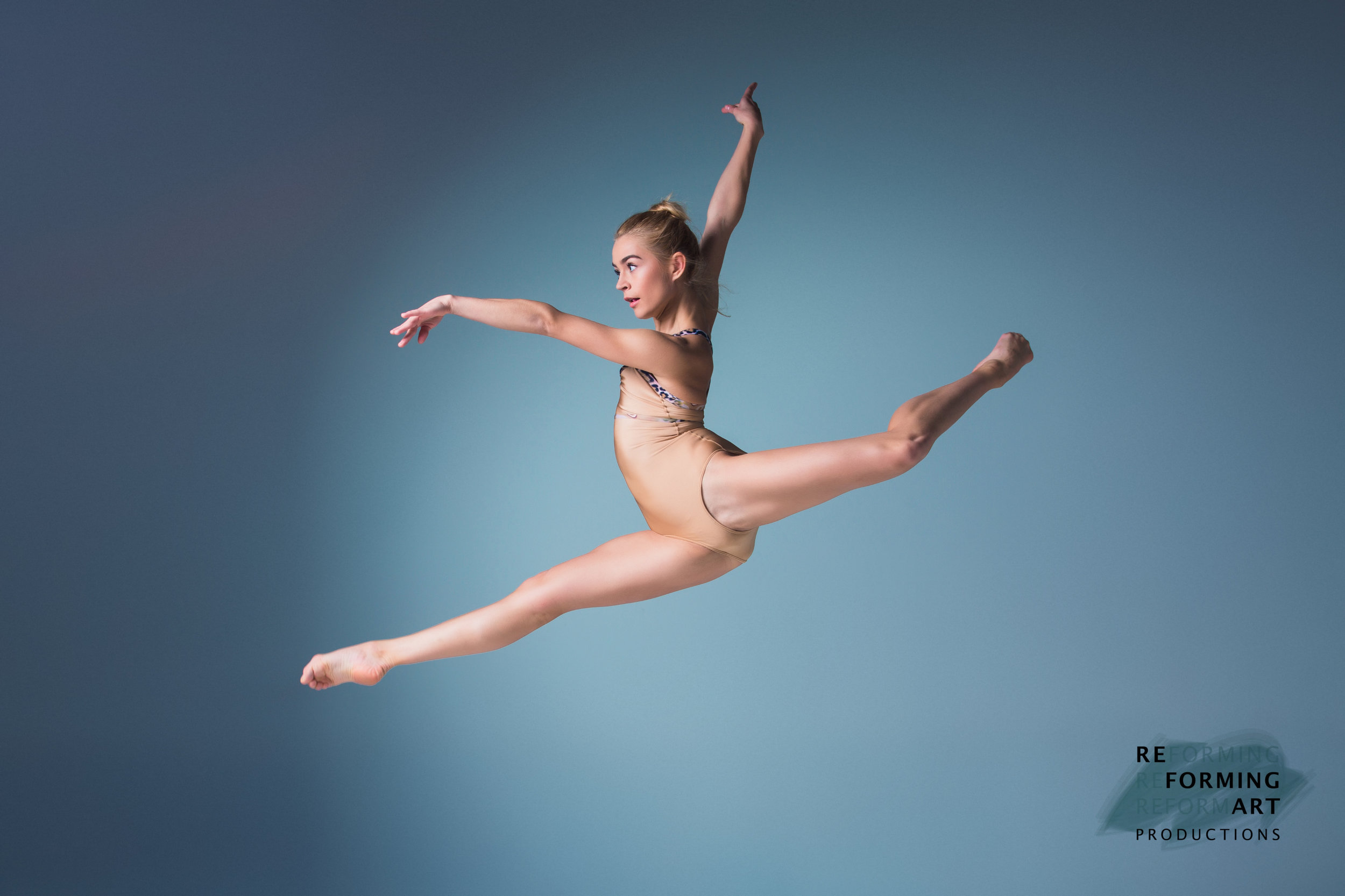 Young-beautiful-modern-style-dancer-jumping-on-a-studio-background-507247572_5401x3601.jpg